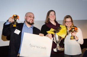 Congratulations to the winners of First Literacy's 27th Corporate Spelling Bee! The team from Eaton Vance—Miles Ferguson, Kate Johnson, and Annie Mitchell—won by correctly spelling tergiversate which means to desert a cause, party or religious faith; to reverse opinions or policy.