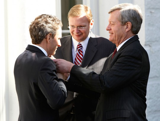Sen. Max Baucus, D-Mont., adjusts Treasury Secretary Tim Geithner's tie as White House Deputy Chief of Staff Jim Messina looks on after President Barack Obama signed the HIRE Act jobs bill in the Rose Garden of the White House in Washington, Thursday, March 18, 2010. (AP Photo/Charles Dharapak)