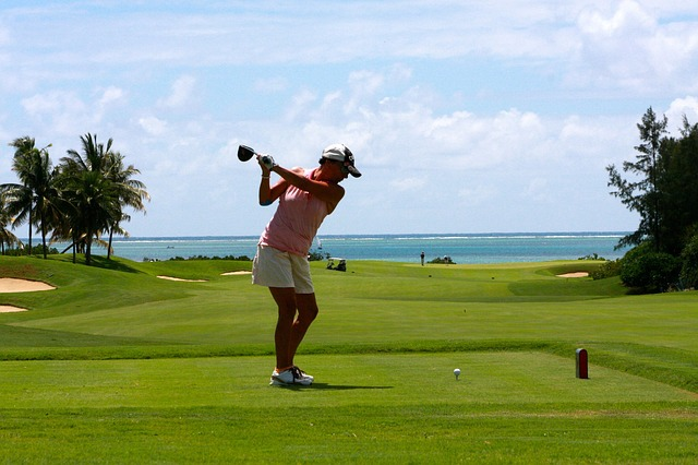 woman playing golf on the new golf course