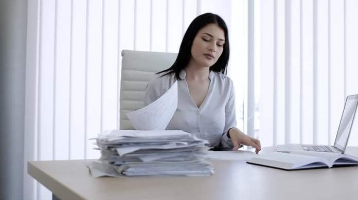 The woman is working in the office