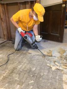 A SBCV disaster relief worker removes damaged flooring in a Baton Rouge home.