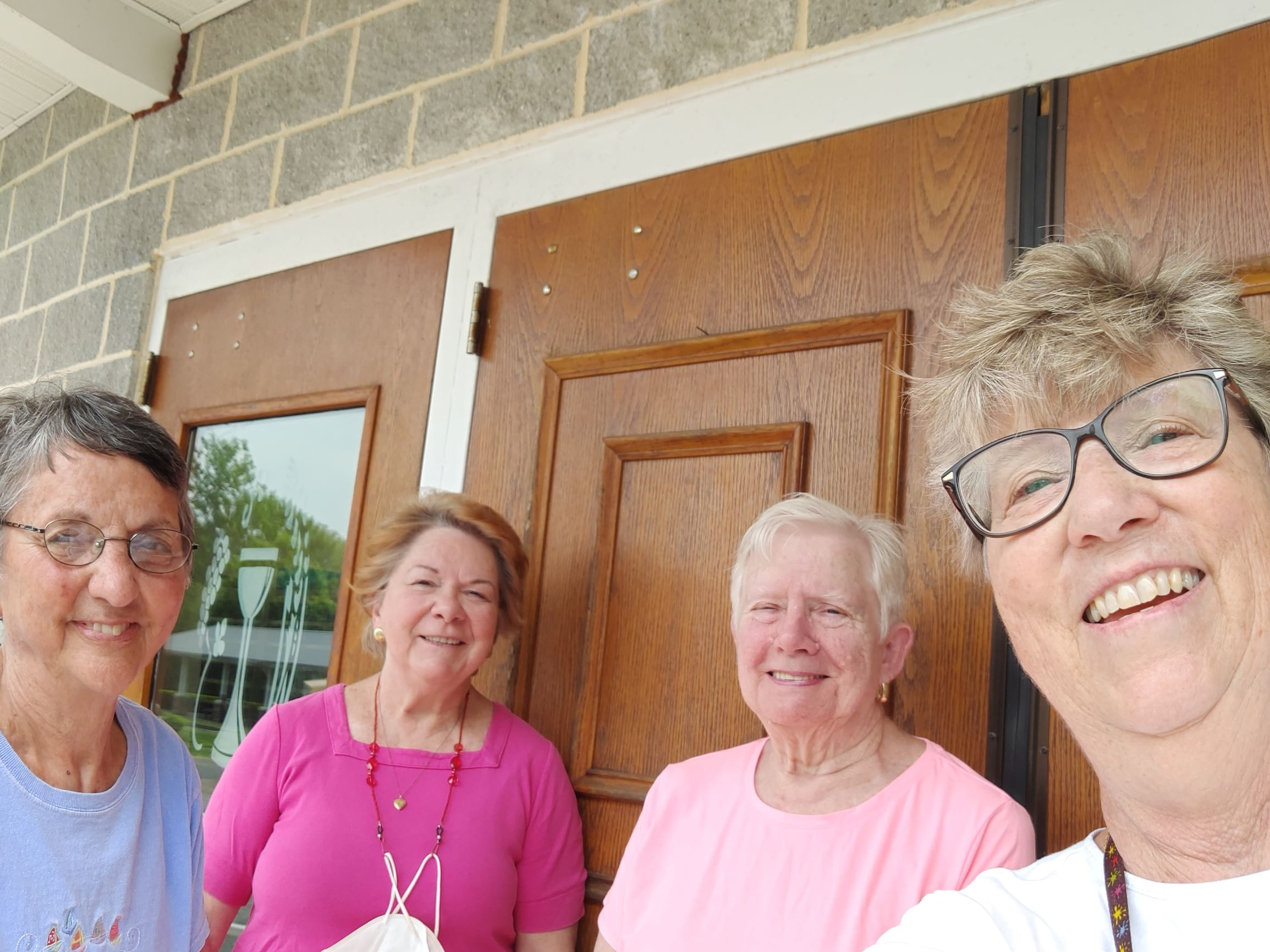 A selfie of mission team members while stocking the food pantry.