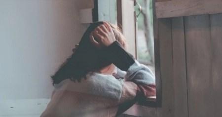sad-woman-at-window