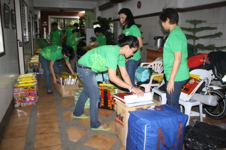 Volunteers getting busy unpacking the goods and re-packing our loot bags.