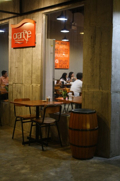 Orange Karenderia has a clean, industrial look but has a spacious, friendly ambiance.