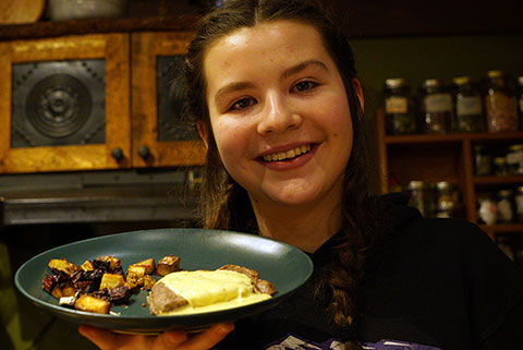 Kate shows off her dinner make completely with local ingredients. Photo by Suzanne Crocker.