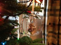 A glass angel in a glass bauble