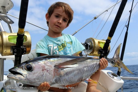 Duarte Jnr. with the Yellowfin that was attacked by a Black Marlin right next to the boat. We quickly bridled the fish with a big circle back to the water with a circle hook but the Marlin did not make a comeback!