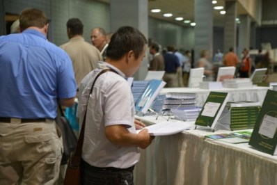 Photo of a member looking at the American Fisheries Society AFS Books at the annual meeting