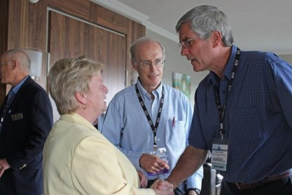 • Photo of American Fisheries Society AFS Leaders Ron Essig and Bob Hughes greet and talk with an AFS Member
