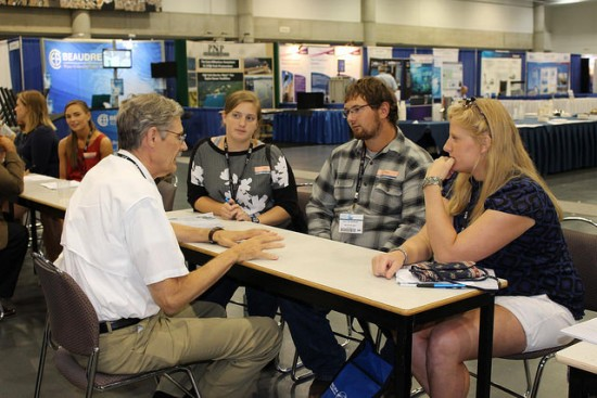 Photo of members networking at the American Fisheries Society