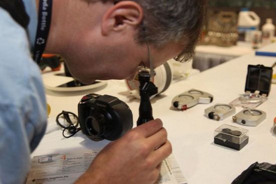 • Photo of an AFS member looking through a microscope for the American Fisheries Society Mission Statement page