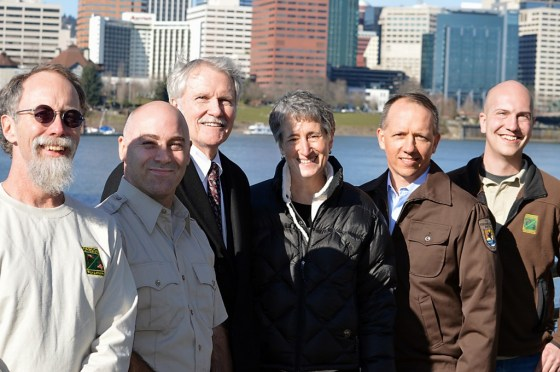 "ODFW biologists Paul Scheerer (left) and Brian Bangs (right) on the Willamette Esplanade with Oregon Gov. John Kitzhaber, U.S. Interior Secretary Sally Jewell, and Chris Allen, U.S. Fish and Wildlife Service biologist, and Rollie White, U.S. Fish and Wildlife Service deputy state supervisor. The photo op took place following the announcement that the Oregon chub is the first fish in the United States to achieve ""recovered"" status under the Endangered Species Act. (Photo by Rick Swart)"