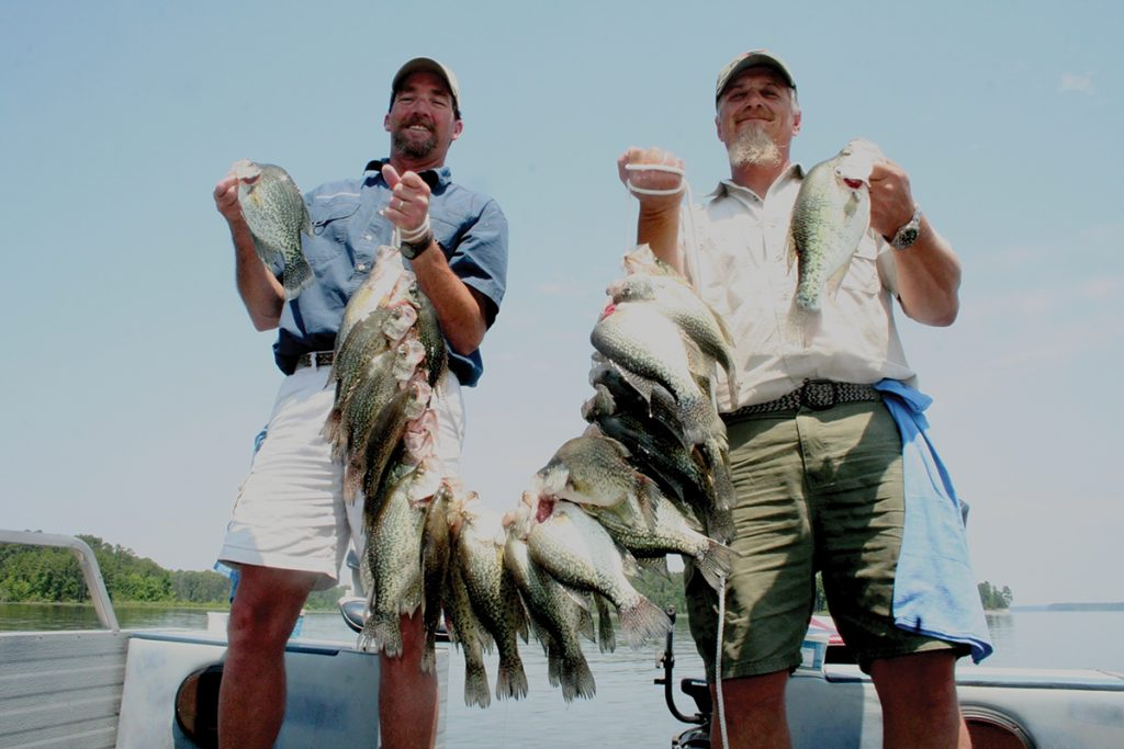 Guides Roger Bacon and Ronnie Burnett with a huge strap of crappie caught on Sam Rayburn.