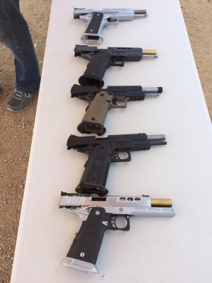 The line-up of STI performance full-size handguns at the media range event.