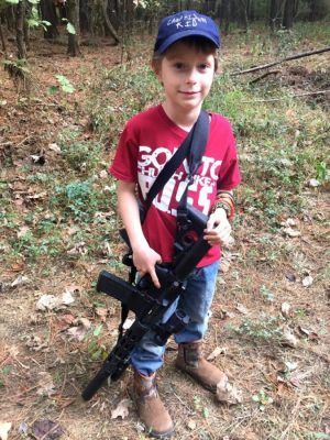My 8 year old out on a hog hunt with my 300 Blackout. That trigger finger!
