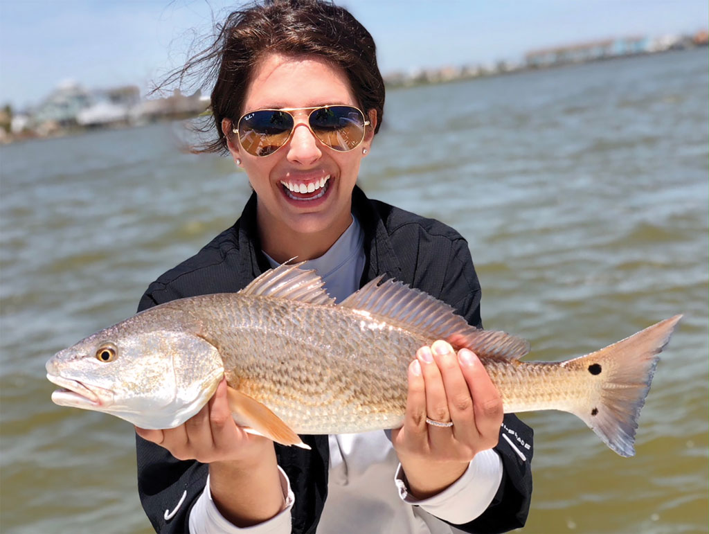 Kelley Bergeson caught this redfish near Tiki Island in Galveston while fishing with her dad, Bruce. She is thankful her dad taught her to love the outdoors.