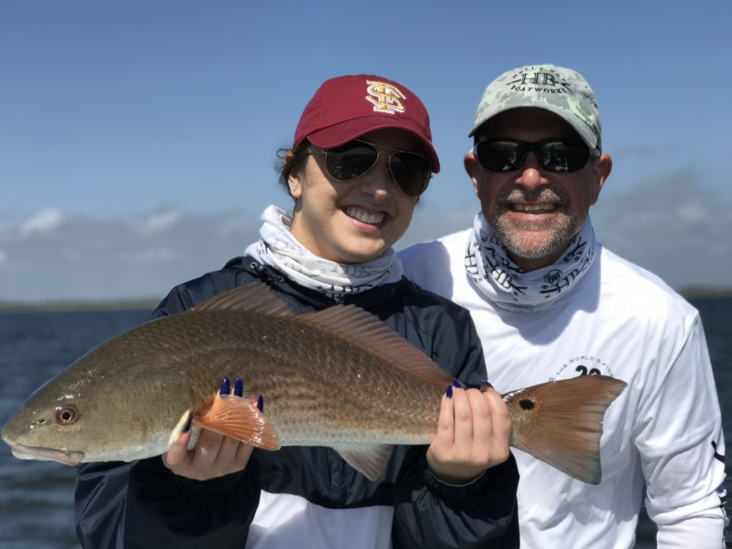 Angler holding a Redfish