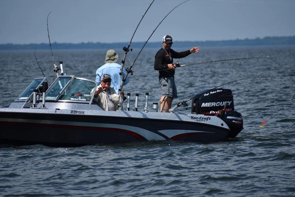 competitive anglers fishing off of a bass boat