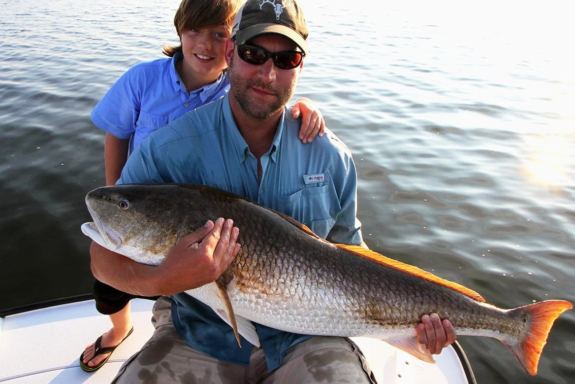 Male angler and son with Bull Redfish caught in the Mosquito Lagoon
