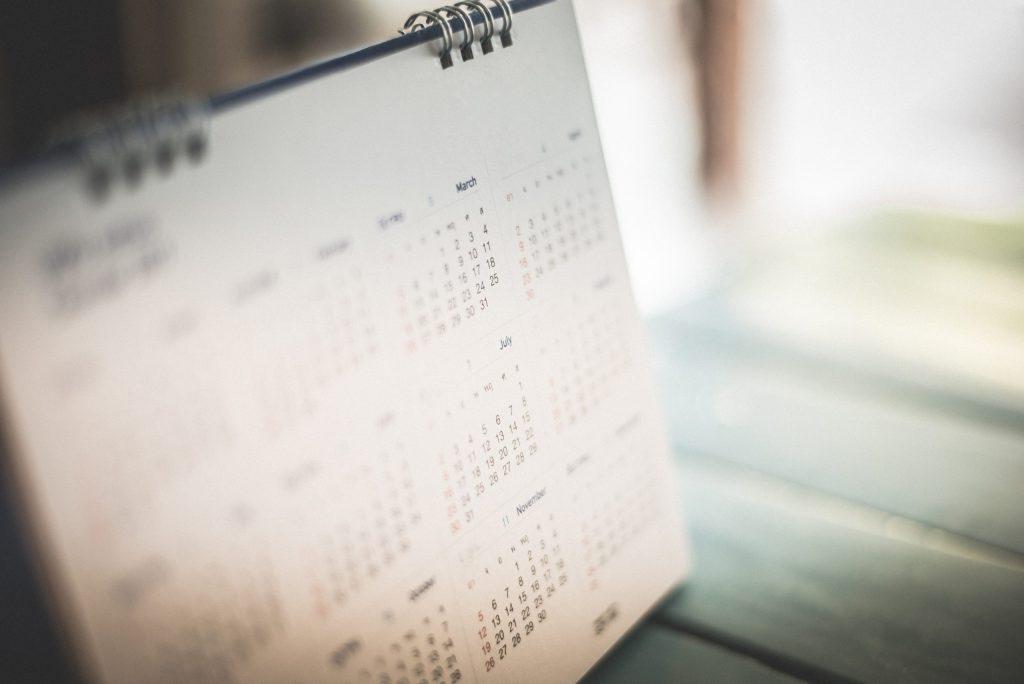 A calendar on a desk.
