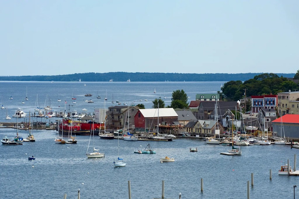 The harbor in Castine, Maine, with traditional downeast fishing boats and sailing yachts in the water
