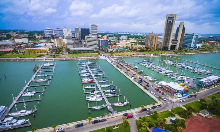 Corpus Christi Marina with charter fishing boats on the water and the city in the background