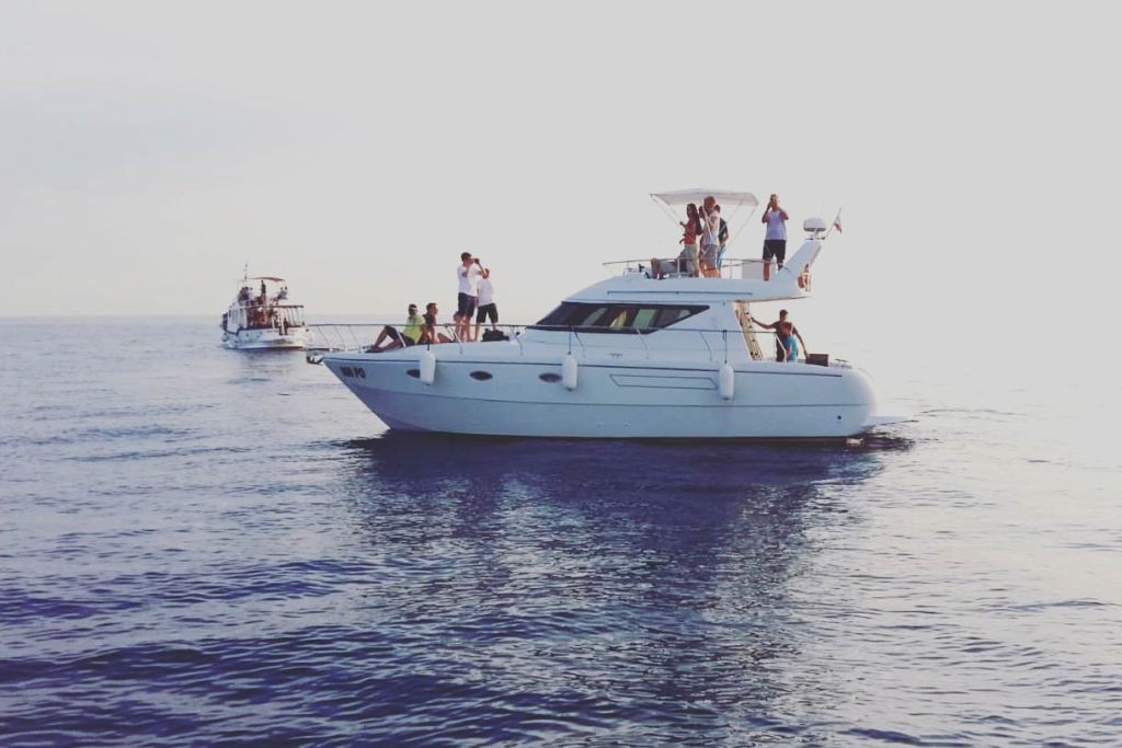 Two charter boats full of guests enjoy the surroundings of the Adriatic Sea