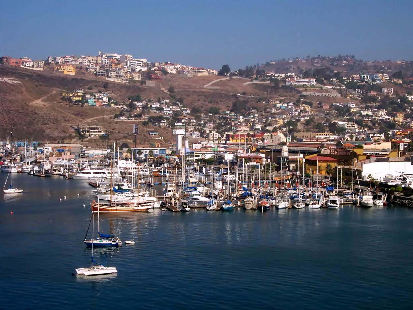 A view of Ensenada from the river with plenty of boats anchored in the harbor