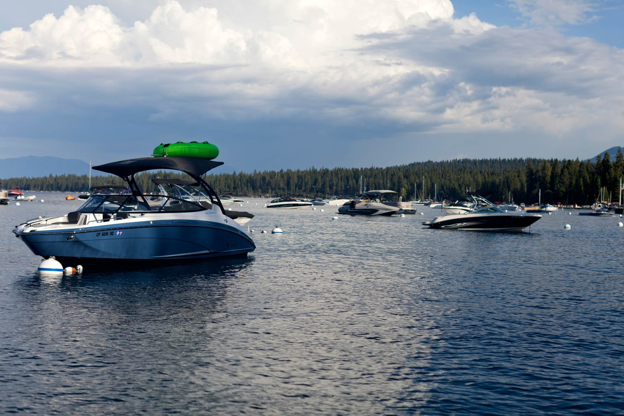 Charter boats scattered in a marina on Lake Tahoe