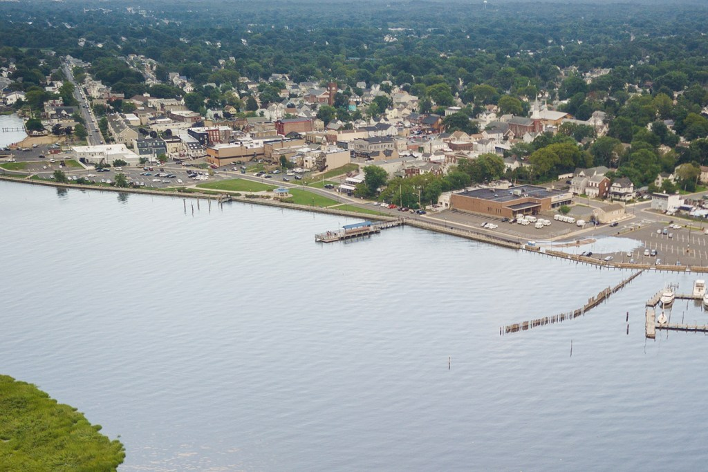 An aerial view of Keyport, NJ, with a fishing beach, small marina, beach and houses in the distance