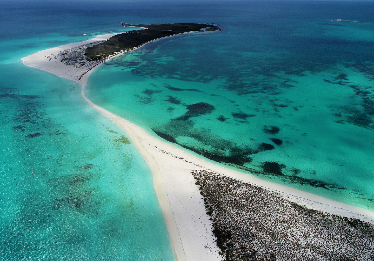 An aerial view of Los Roques, Venezuela, with white sands and shallow, turquoise water