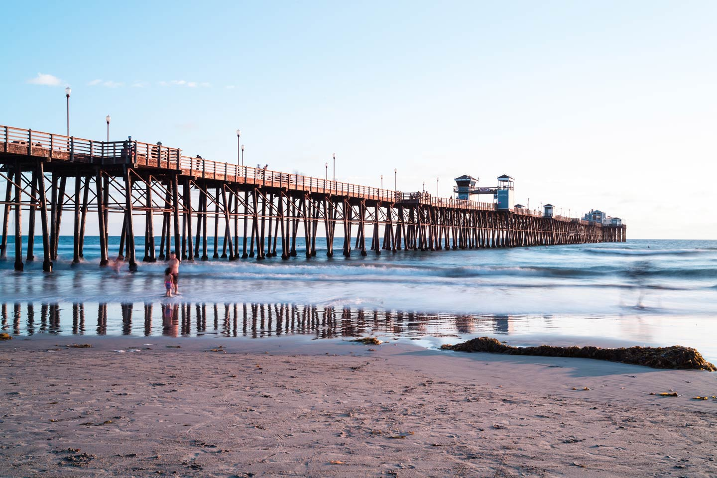 A view of the iconic Oceanside Pier from the beach