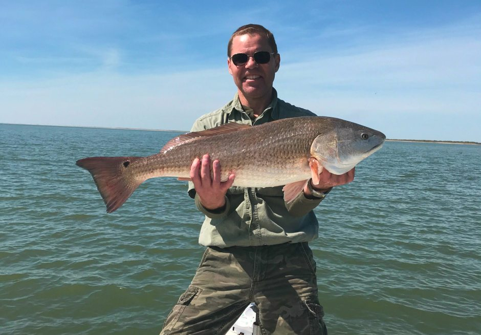 Paul Hale holding Redfish on Lake Calcasieu, LA