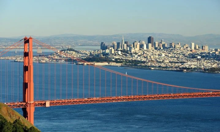 The Golden Gate Bridge with water and the city of San Francisco in the background