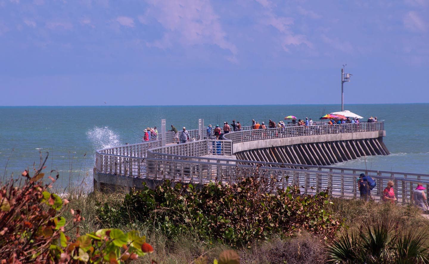 A view of a Sebastian Inlet fishing pier stretching out onto the ocean