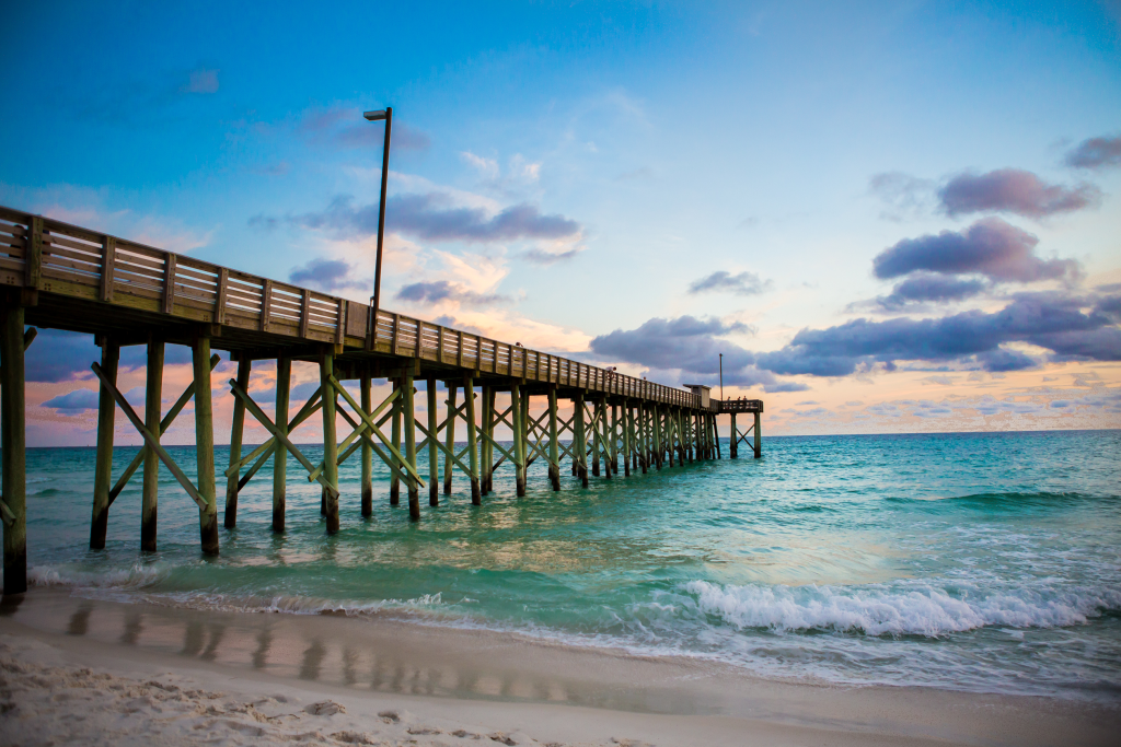 An old-fashioned fishing pier at sunset in Panama City's St Andrews State Park