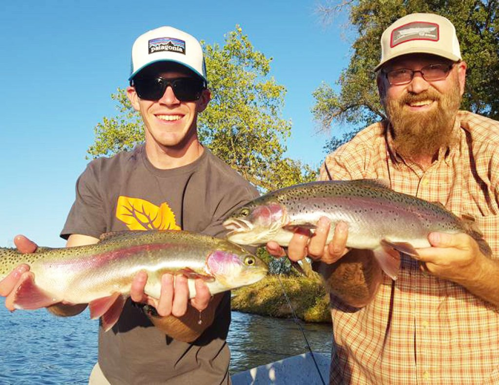 Two men holding Rainbow Trout.