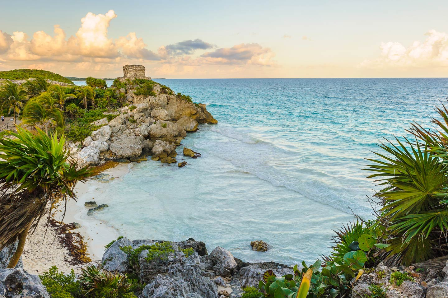The castle at Tulum on the beach at sunset