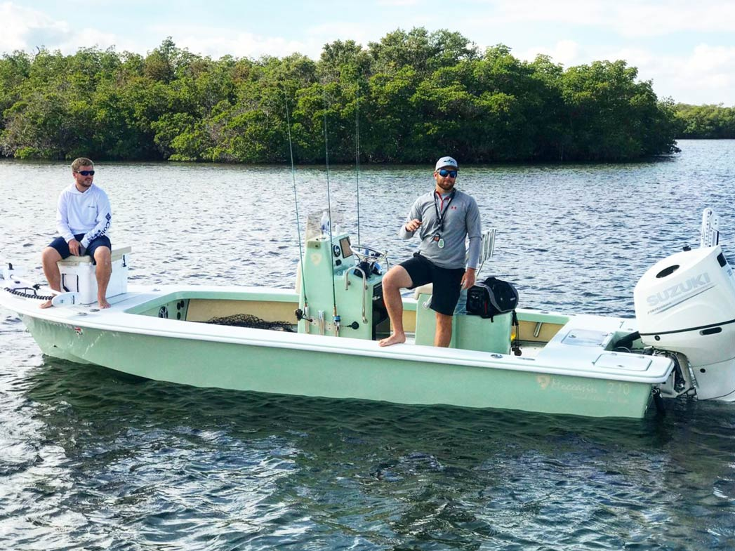 Two men sit on a charter boat on the Indian River