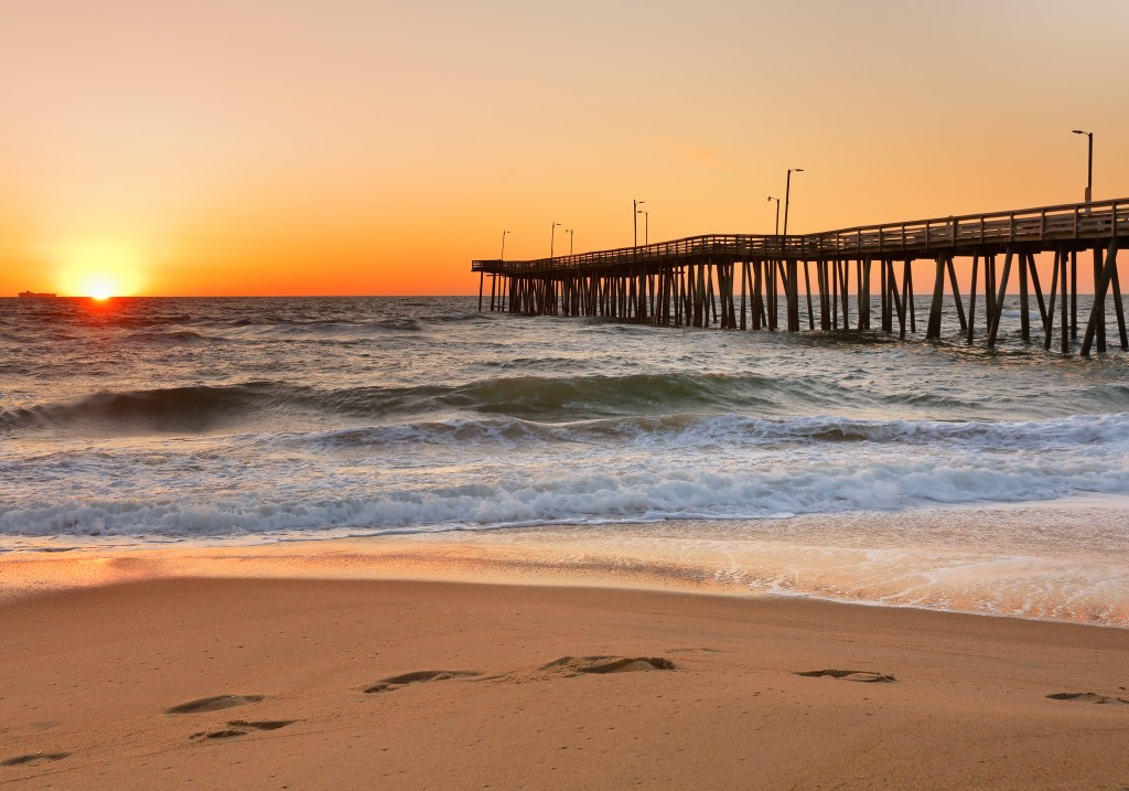 A view of Virginia Beach Fishing Pier at sunrise