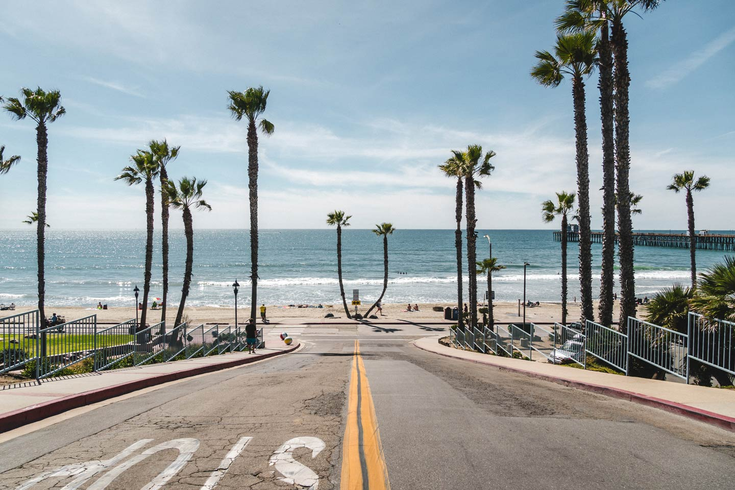 The palm tree-lined road to the Oceanside Pier and Harbor.