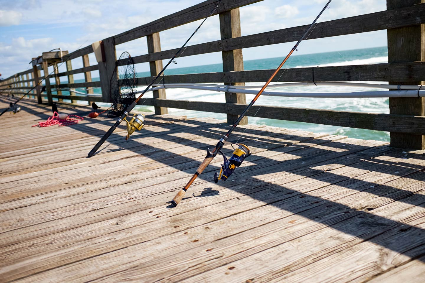 Fishing rods lined up on fishing pier in New Smyrna Beach