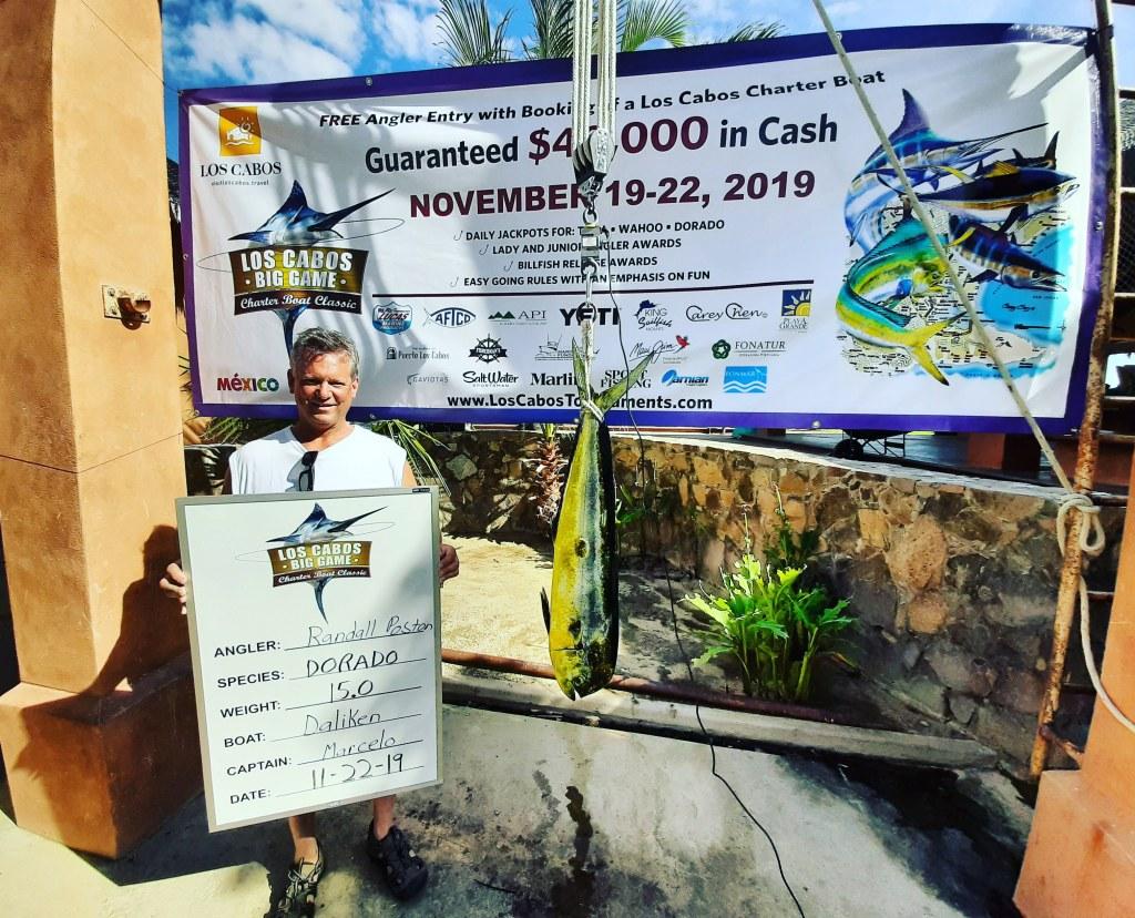 Man with trophy mahi mahi at a fishing tournament