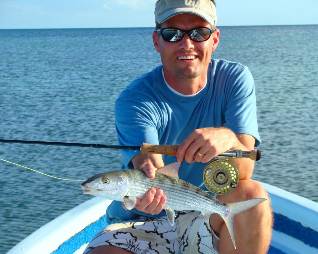 a fly angler holding a bonefish