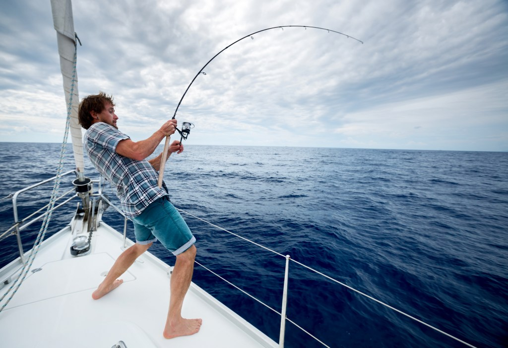 an angler battling a fish from a boat
