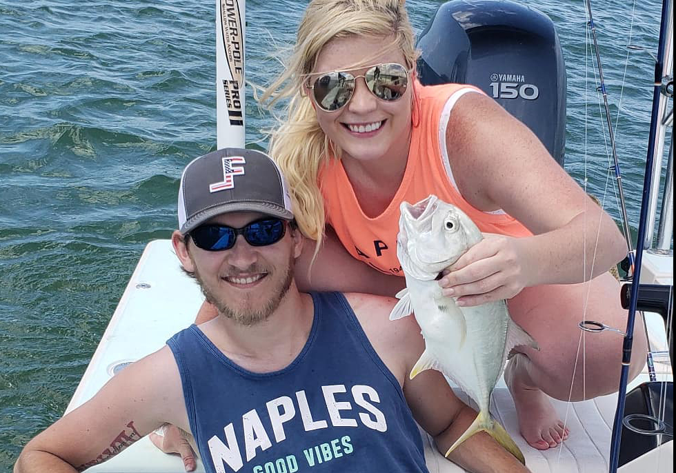 man and woman on boat with jack crevalle