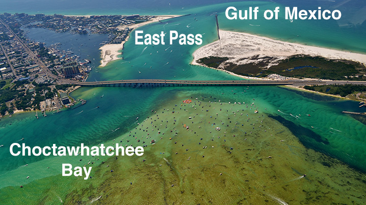 Aerial view of the East Pass, Gulf of Mexico, and Destin bay with hundreds of boats going towards Crab Island