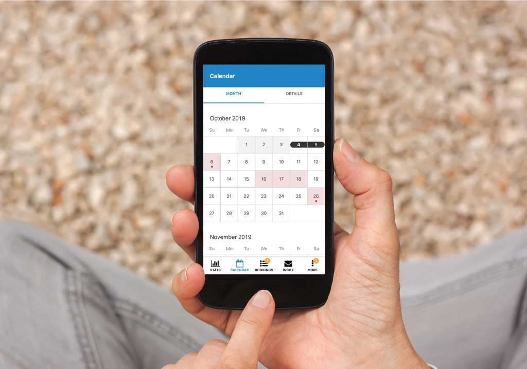 Person sitting and using new calendar on their phone