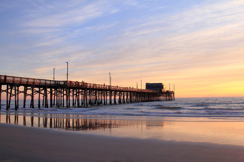 The landmark Newport Beach Pier at sunset.